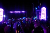 Bright lights and a crowd of glowsticks at the starting line of the San Diego Electric Run.