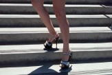 Close-up of a woman wearing high-heels and her legs
