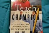 Close-up of text book entitled Teach like a Champion