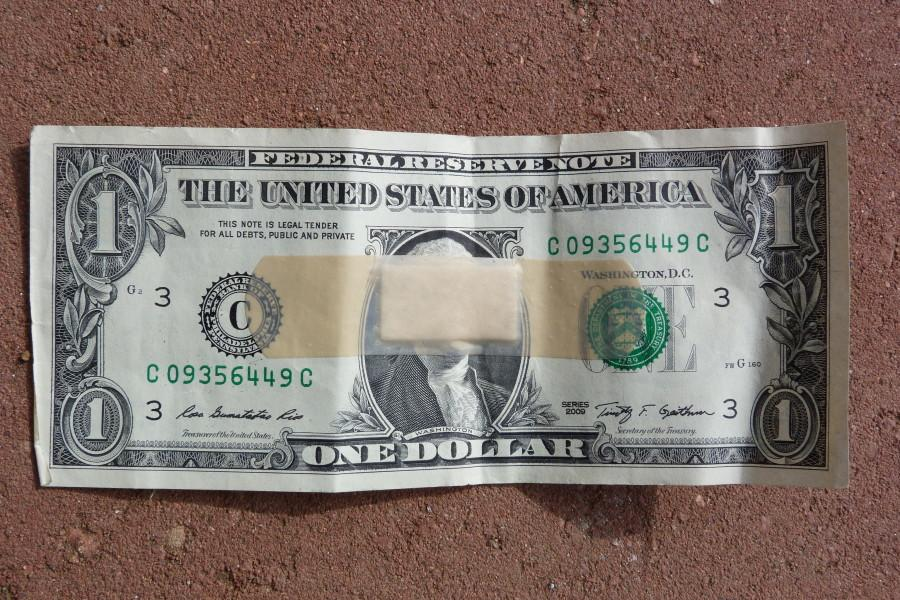 dollar bill with a band-aid