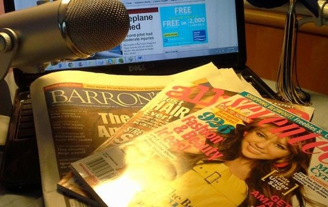 Computer screen and magazines