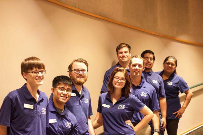 Pictured left to right are eight members of the ASI Board of Directors. Grady Mitchell, James Ferrales, Mads Elton Milsen, Rhiannon Ripley, Brian Newbury, Joshua Maffei, Carlos Morales, and Yazmin Doroteo.