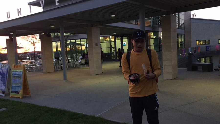 Student Alex Maravillas with his teriyaki bowl in front of the USU during the evacuation. Photo courtesy of Alex Maravillas and Marquessa Castorena.