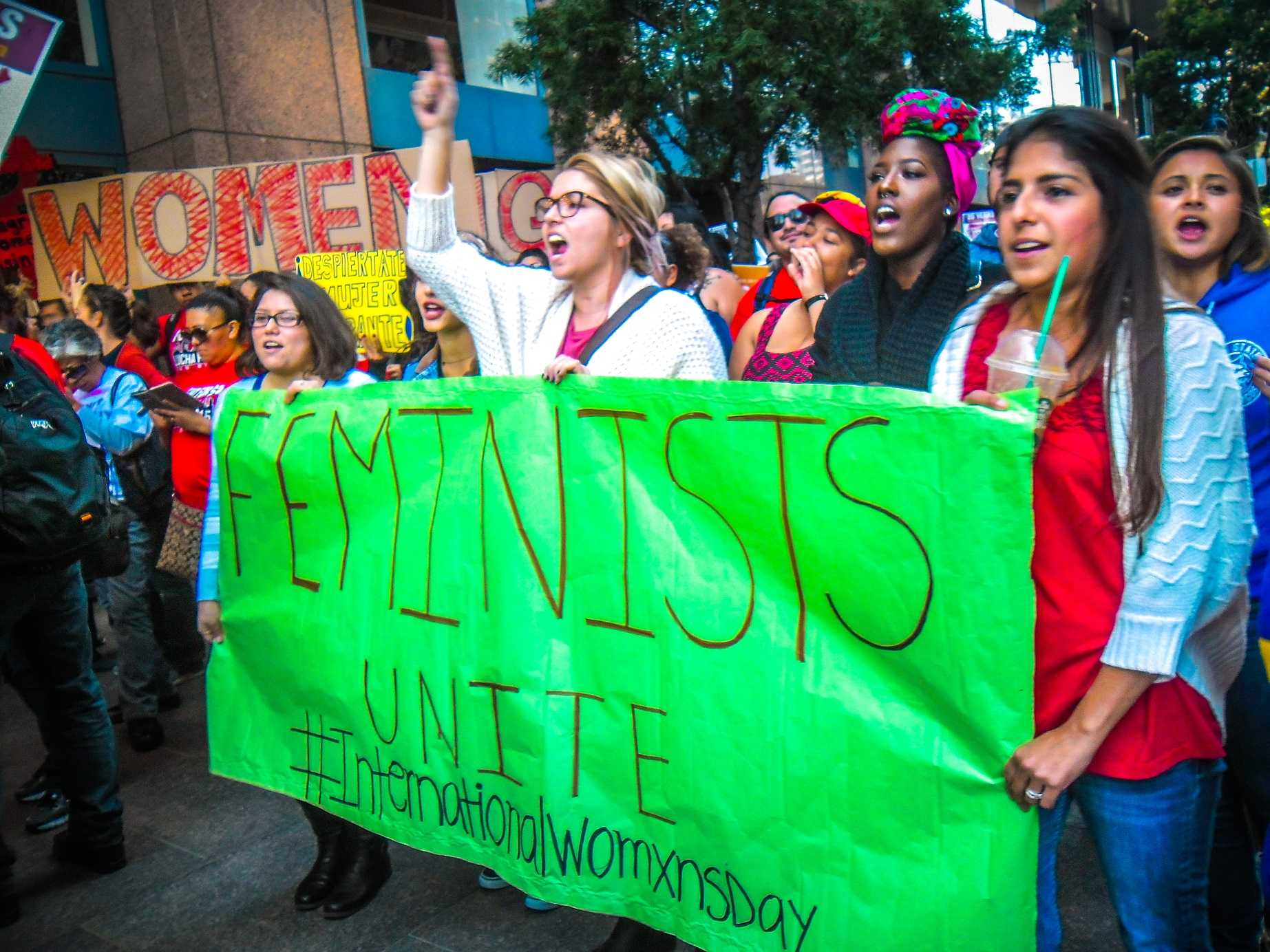 Members of CSUSM's Feminists Unite group march on International Women's Day.