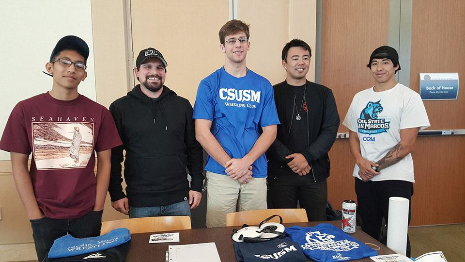 From left to right Justin Acala, David Mosley, Connor Shin, Donovan Lay and Sebastian Ring at a booth representing their wrestling club.