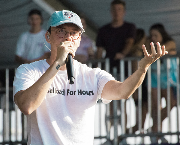 Logic speaks to the crowd during his Saturday performance.