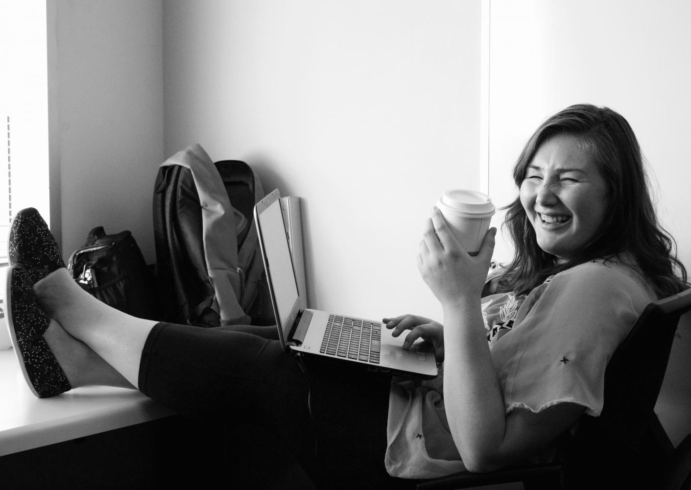 Meghan enjoying her coffee in the Cougar Chronicle office where she feels right at home.