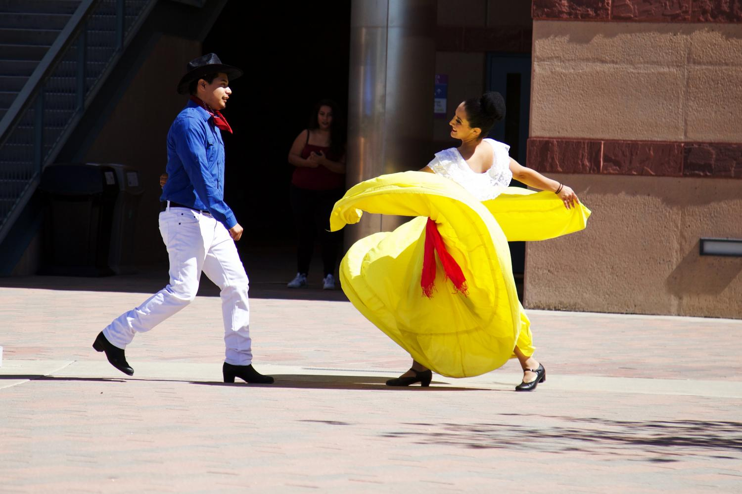 Saul Rojas and Lorena Santiago performing a duet called El Coyote on Oct. 5 in front of University Hall.