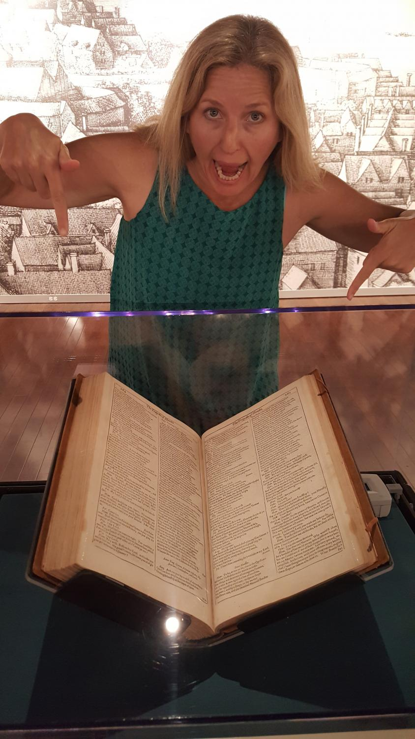 Professor Cynthia Headley with William Shakespeare's first folio/manuscript at the San Diego Library