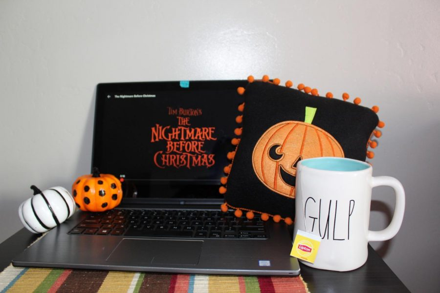 Your favorite Halloween movies with a cup of tea on chilly afternoons is a great and relaxing way to spend your fall. Credit: Photo illustration by Jada Mullins.