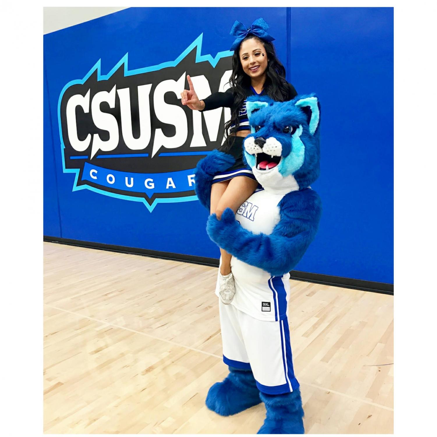 Crash the Cougar in his new look together with cheerleader Tatum Rios.