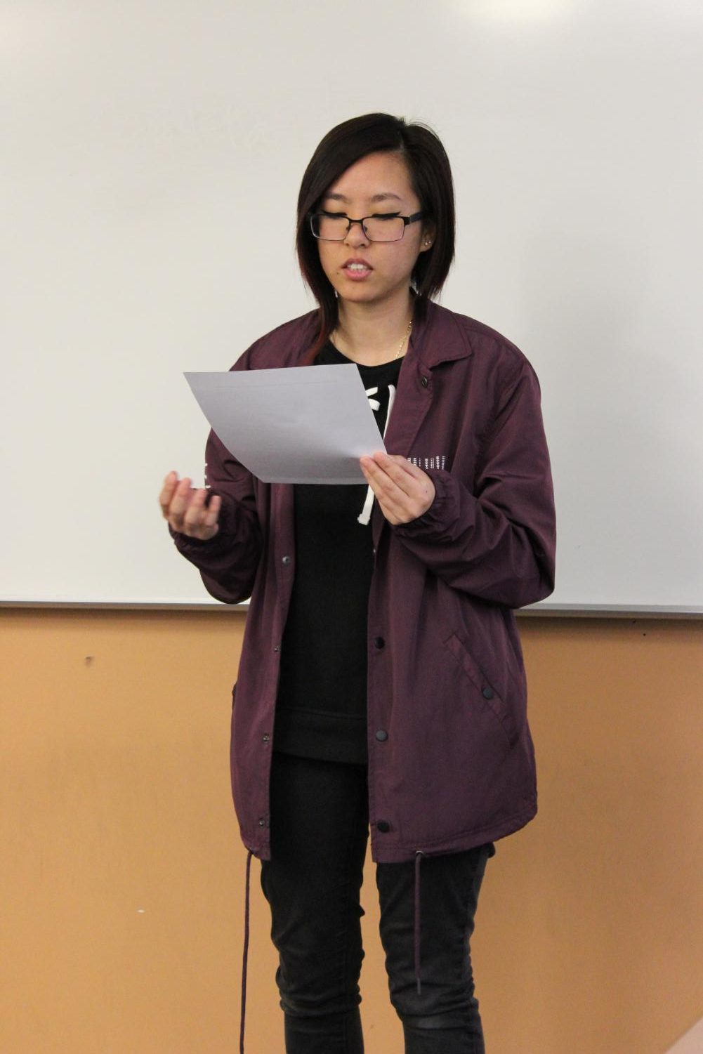 Student showcases her piece at the Literature Club Open Mic during U-hour, Thursday, Nov. 30.