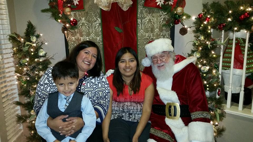 Provided by Bryanna Martinez  The Saiz family, Christopher, Denise and Bryanna, take their annual photo with Santa.