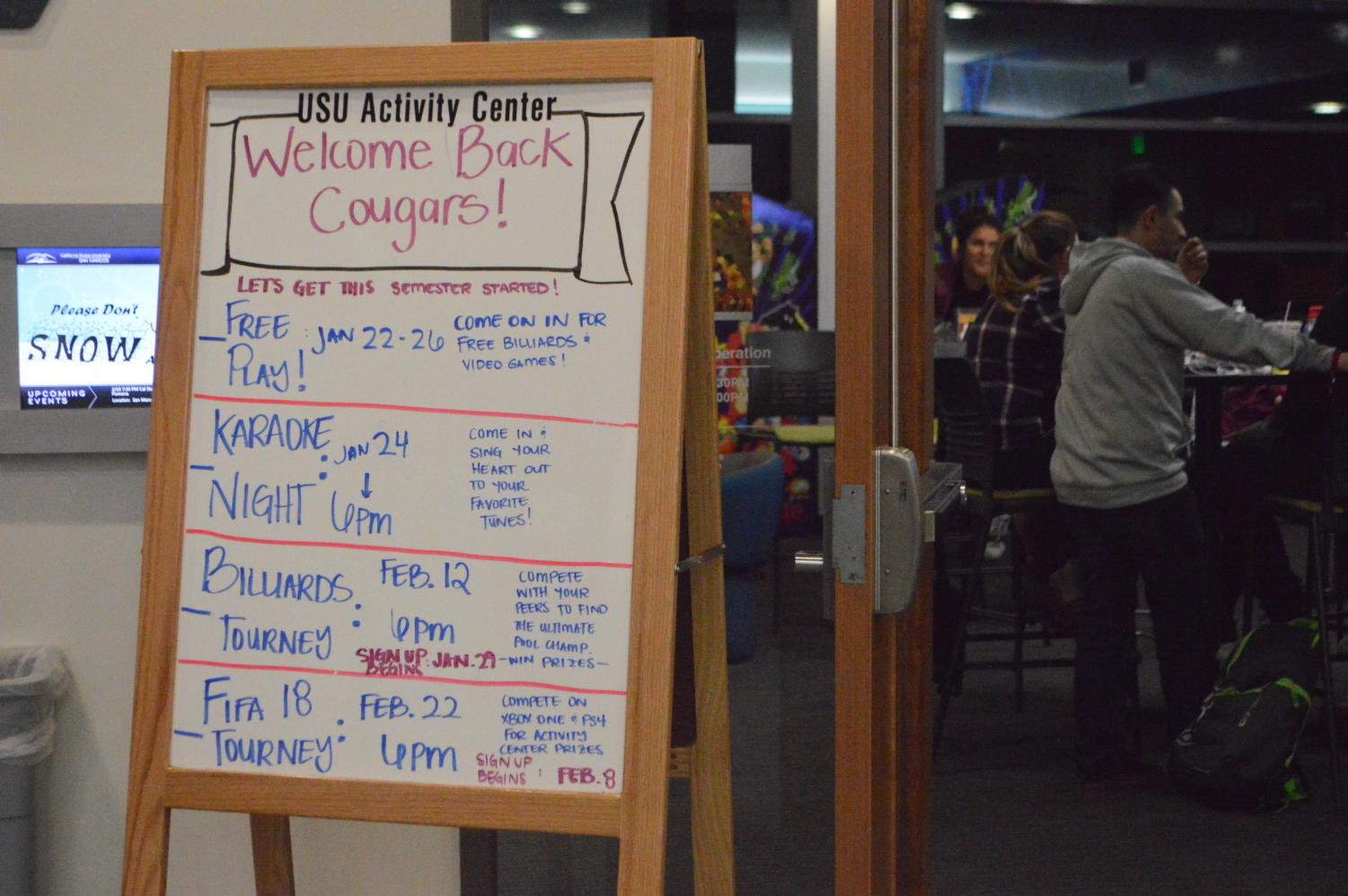 Behind the doors of the USU Activity Center, students participate in a Wednesday Karaoke night, one of the many Welcome-back events held in this room.