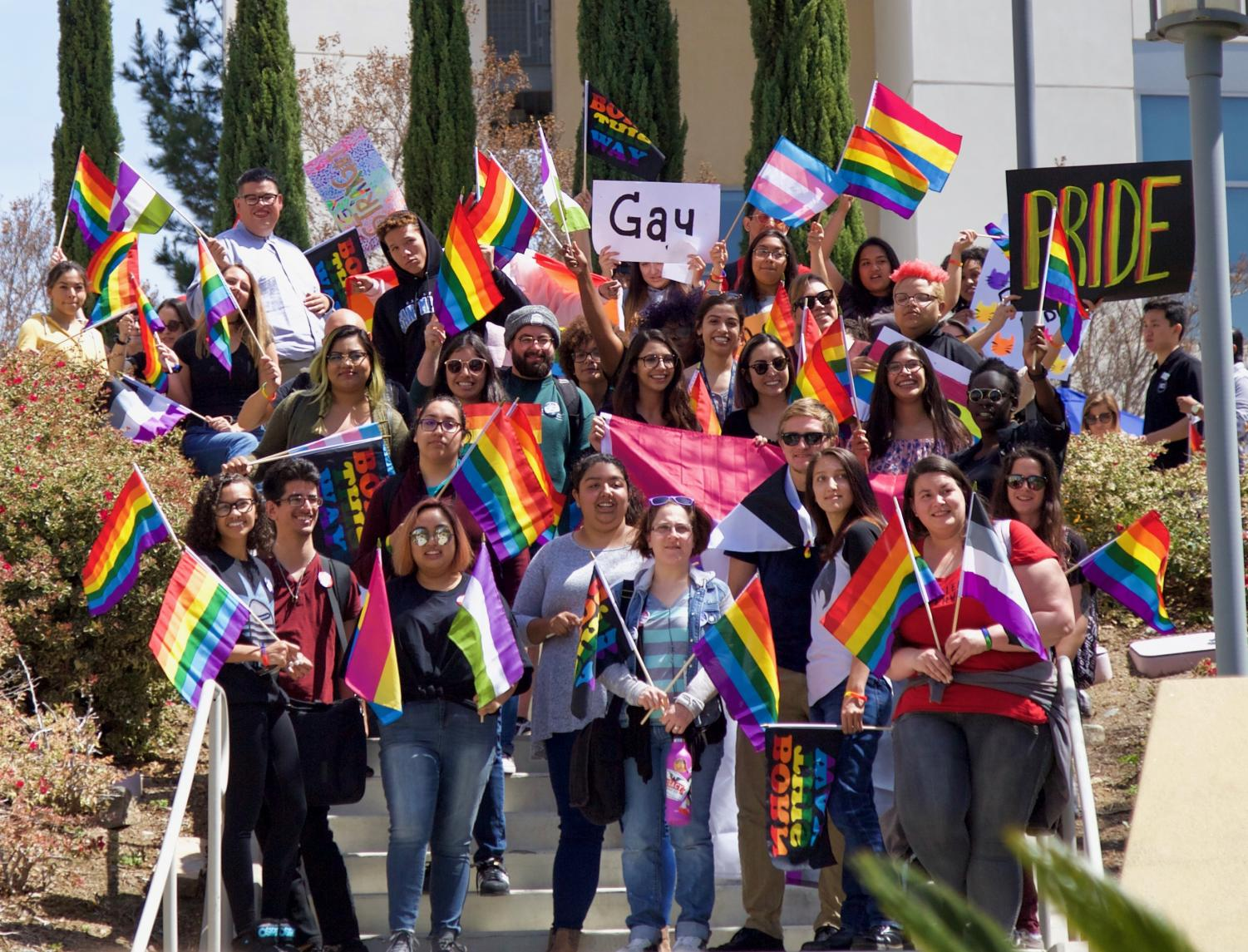 Proud cougars join in solidarity to walk in CSUSM's annual Pride Walk on Apr. 3.