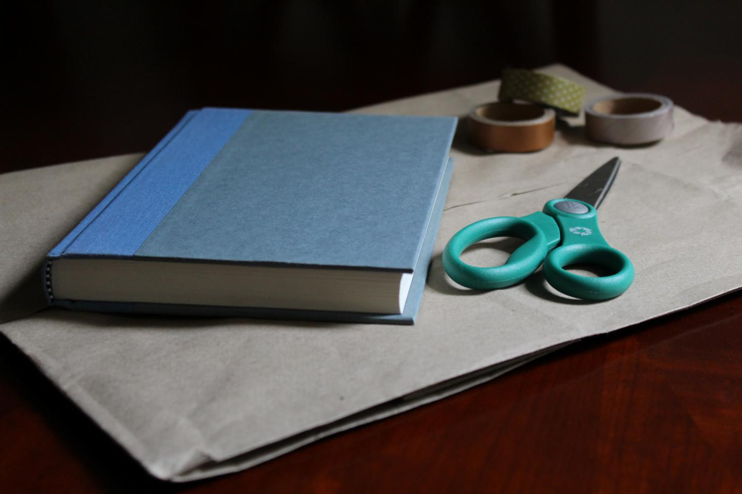 Only a few household materials are needed to create a book cover.
