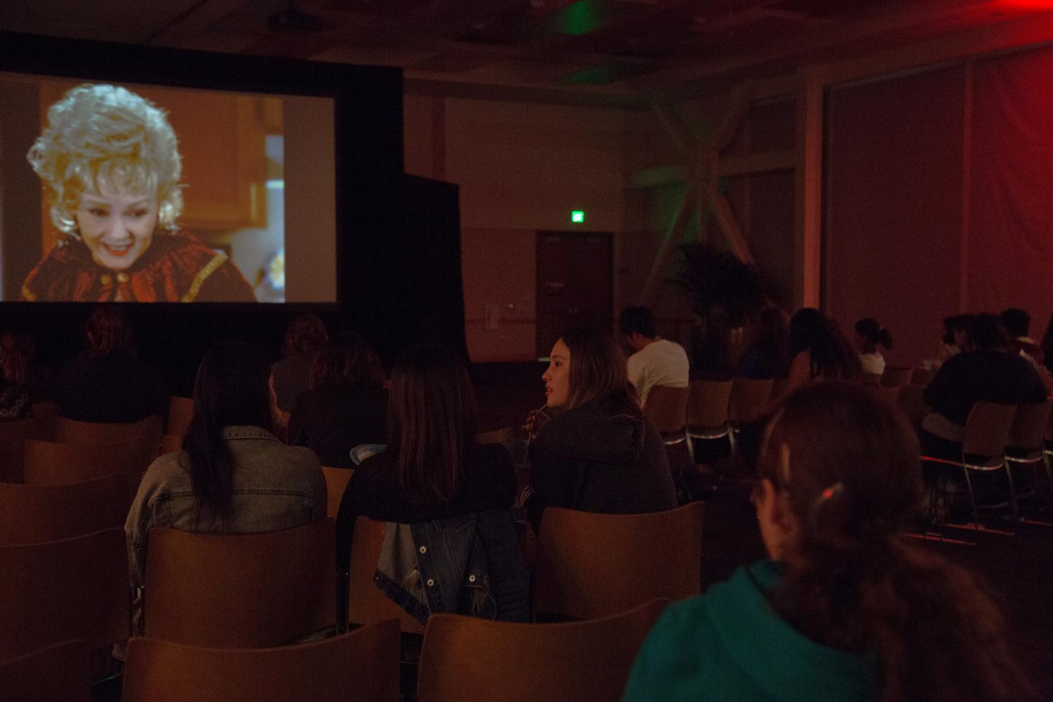 On Oct. 16 students gather around a screen in the USU ballroom to watch the classic film, Halloweentown
