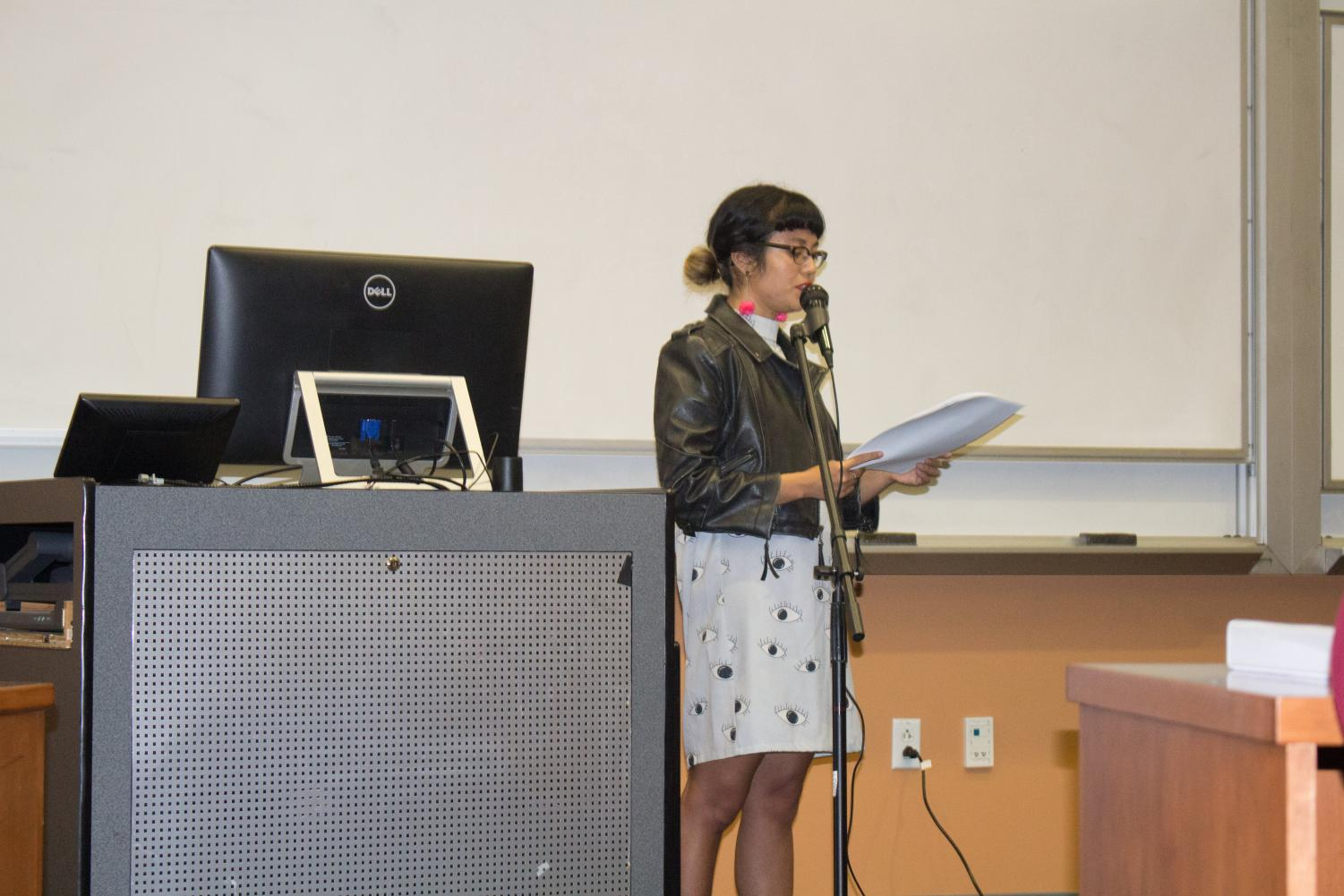Speaker Jackie Wang reads to audience members at a Liteary series event Oct. 4.