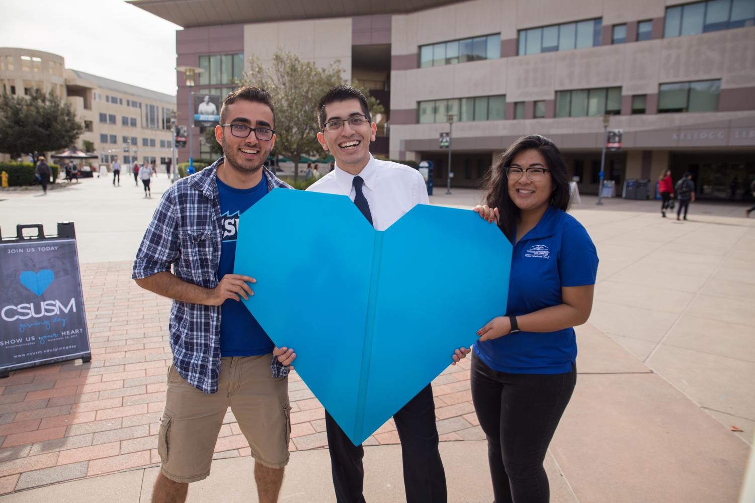 Students from the CSUSM Student Philanthropy Council, from left to right (I need to ask someone), then Chris Morales, and Anna Rapada.