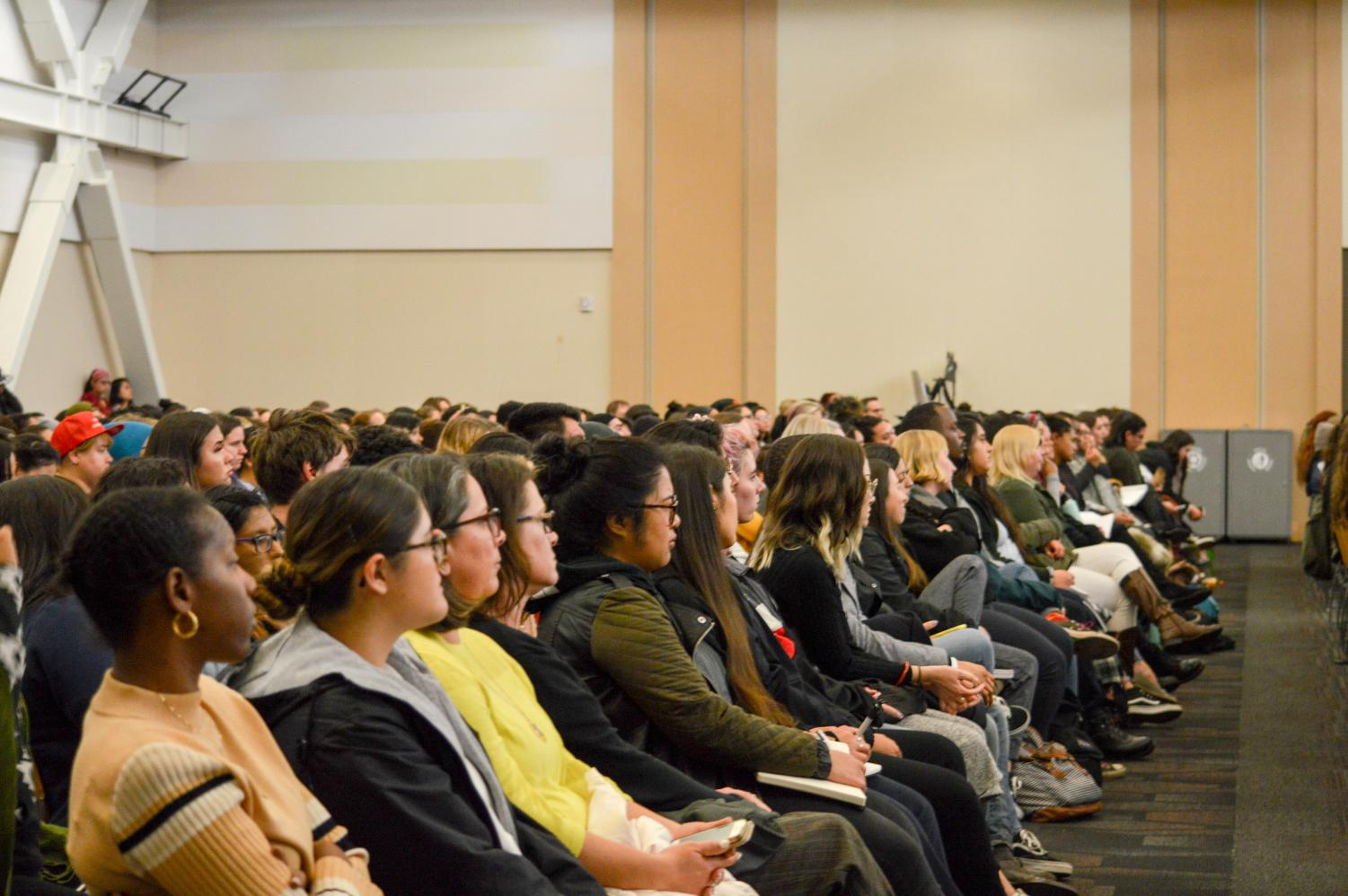 Founder of the Me Too movement, Tarana Burke speaks to a crowd of students. Students sit gathered in the USU ballroom to listen to Tarana Burke's speech.