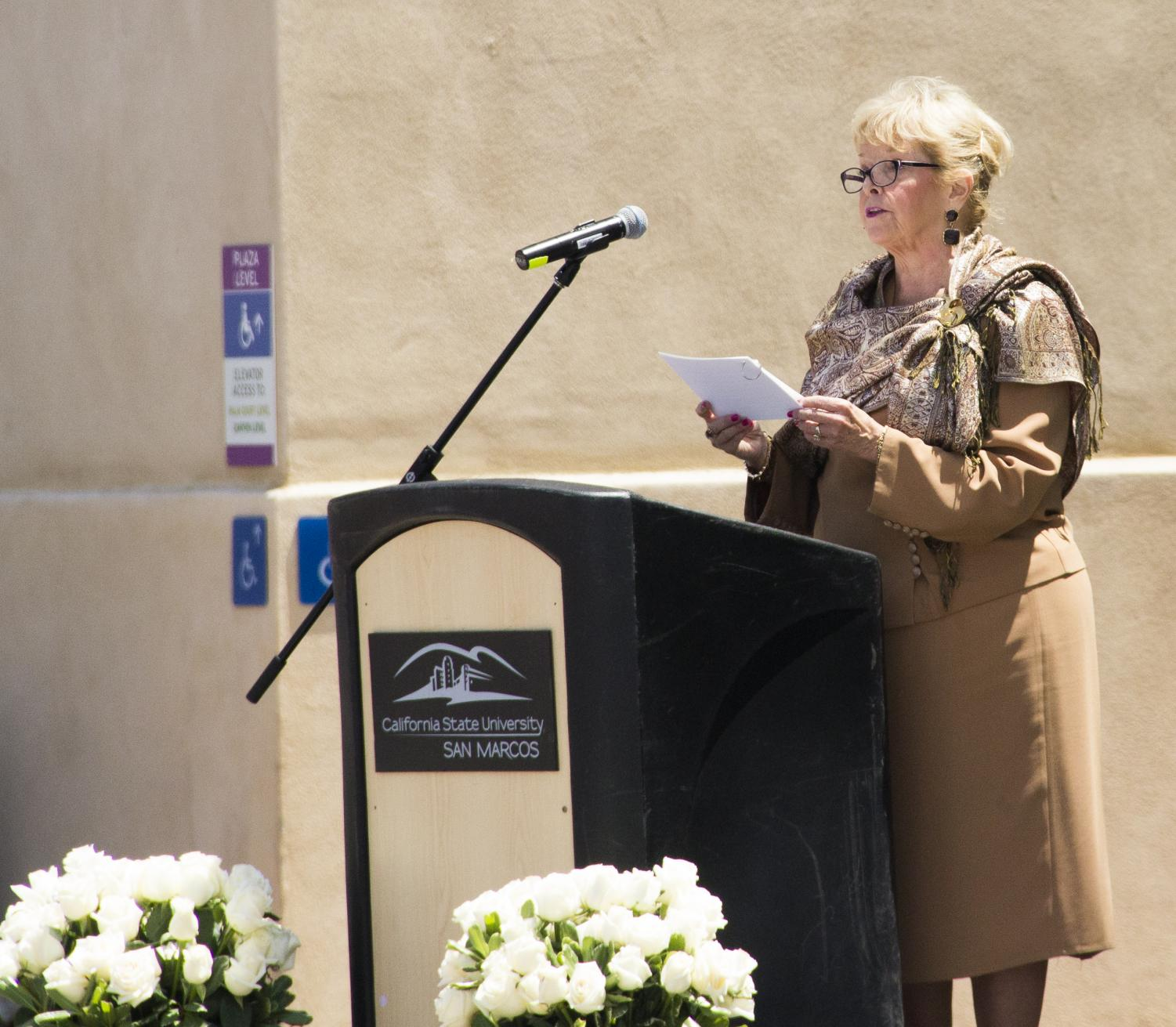 CSUSM president Haynes speaks to the crowd at the white rose memorial on May 1.