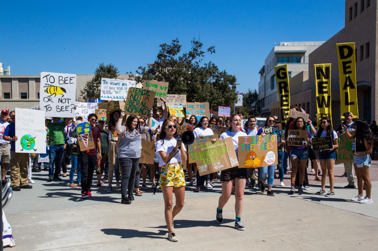 Estefania Fraticelli (left) and Lindsey Cain (right) lead protestors in a solidarity march on Sept. 24.