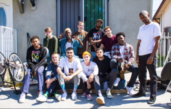 BROCKHAMPTON sits outside their home in south central in LA.