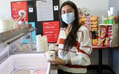 Paola Ochoa works in her family-owned restaurant while also starting her own small business making custom chocolate covered strawberries.