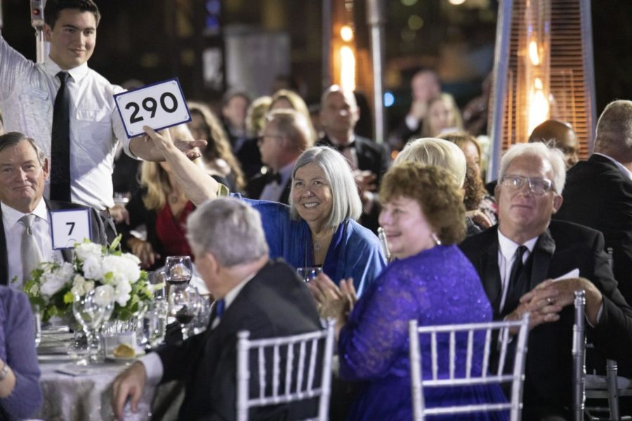 Longtime donor to CSUSM Darlene Shiley (center, holding up a sign) wants to add Haynes' name to the institute. Shiley is pictured at CSUSM's annual fundraising gala in June 2019.